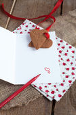 Love letter with heart shape cookies, hearts and red felt pen — Stockfoto