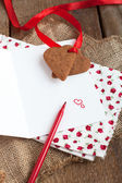 Love letter with heart shape cookies, hearts and red felt pen — Photo