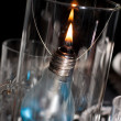 A candle made ​​of light bulb - Stock Photo