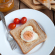 Royalty-Free Stock Photo: Toast with fried egg in the shape of heart and cherry tomatoes