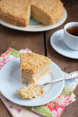 Cake Napoleon of puff pastry with custard cream on a plate — Stock Photo