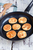 Delicious homemade cheese pancakes with raisin in a pan — Stock Photo