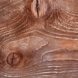 Texture - artificially aged frayed wooden board with knots - Stockfoto