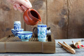 Traditional chinese tea ceremony accessories on the tea table — Stock Photo
