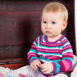 Little serious baby girl in a suitcase — Stock Photo #21013127