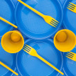 Royalty-Free Stock Photo: Bright plastic disposable tableware, background