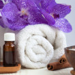 Spa still life with aromatic candle, orchid flower, towel, aroma — Stock Photo