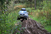 Off-road Action in the forest, 4x4, mud and vehicle — Stock Photo