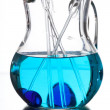 Glass jug with blue water and the reflection in the mirror — Stock Photo