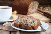 Banana bread with nuts with cup of coffee — Stok fotoğraf