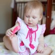 Lovely blond Baby girl playing with toy, selective focus  — Stock Photo