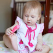 Lovely blond Baby girl playing with toy, selective focus — Stock Photo #23186600