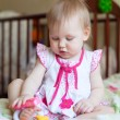Lovely blond Baby girl playing with toys  — Stock Photo