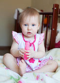 Lovely blond Baby girl with blue eyes playing with toy, selectiv — Stock Photo