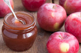 Apple confiture in Glass Jar with apples on the wooden table — Stock Photo