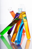 Test tubes with colored liquid in the spectrum colors on a white — Stock Photo