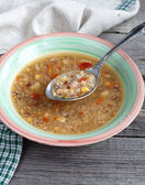 Vegetarian soup with quinoa, rice red, yellow lentils, corn, pep — Stock Photo