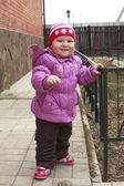 Little cute girl on a walk in the spring in a jacket and hat — Stock Photo