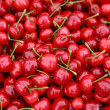Ripe red cherries with sticks background — Stock Photo #25528735