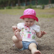 Cute  little girl on beach playing with sand, Selective focus on — Stock Photo