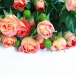 Beautiful bouquet of roses on white wooden table, selective focu — Stock Photo #27527559