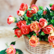 Beautiful bouquet of roses in basket — Stock Photo