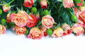 Beautiful bouquet of roses on white wooden table, selective focu — Stock Photo