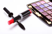 Multicolored eye shadows palette, red Lipstick and black mascara — Stock Photo