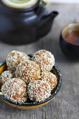 Carrot halva balls in coconut chips, Indian sweet, selective foc — Stock Photo