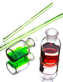 Chemistry laboratory glassware with colour liquids in them — Stock Photo