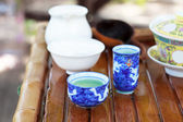 Traditional chinese tea ceremony accessories (tea cups) on the t — Stock Photo
