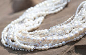 Necklace with large pearls and pheonites, some pearls in focus s — Stock Photo