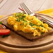 Royalty-Free Stock Photo: Scrambled eggs with chives on a slice of wholemeal bread