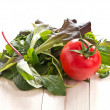Stock Photo: Italipicking salad with fresh tomatoes