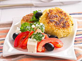 From rice patties with red pepper feta cheese olives salad — Stock Photo