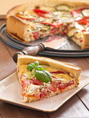 Quiche with tomatoes and zucchini — Stock Photo