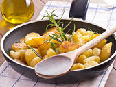 Fried potatoes in a pan — Stock Photo