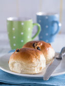 Buns with coffee cups in the background — Stock Photo