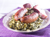 Kale with sausage — Stock Photo