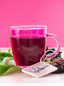 Fruit tea with elderberry berries and leaves — Stock Photo