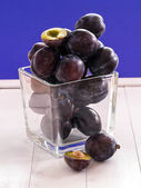 Plums in a glass — Stock Photo