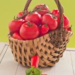 Stock Photo: Tomatoes and peppers in a basket