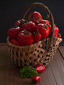 Tomatoes and peppers in a basket — Stock Photo