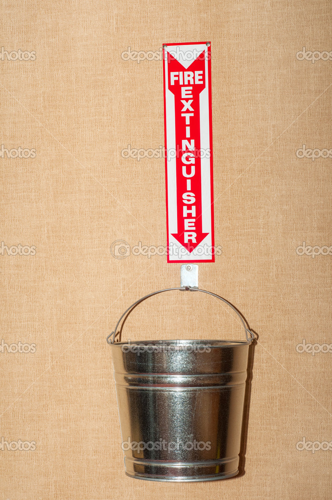 Humorous depiction of a bucket as a low-budget fire extinguisher — Stock Photo #18343599
