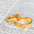 Stock Photo: Rings on marriage chapter