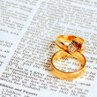 Wedding rings on Bible — Stock Photo