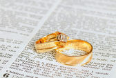 Rings on marriage chapter — Stock Photo