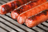 Hot dogs grilling — Stock Photo