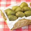 Kiwi fruits served in a basket — Stock Photo