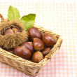 Chestnuts was served in a basket - Stock Photo